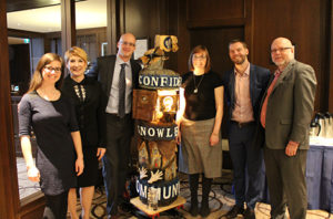Momentum's leadership team stands proudly beside our new Totem
